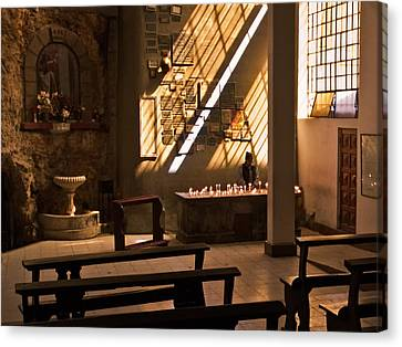Canvas Print featuring the photograph Lighting Candles by Ron Dubin
