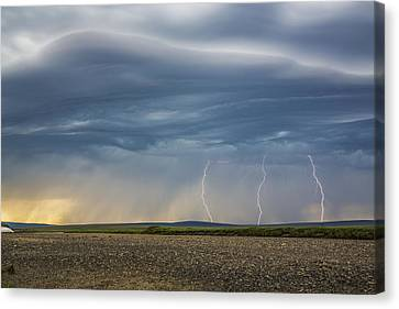 Lightning Bolts Descend From Dark Canvas Print by David Shaw