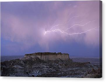 Lightning Strikes Above A Butte Canvas Print by Joel Sartore