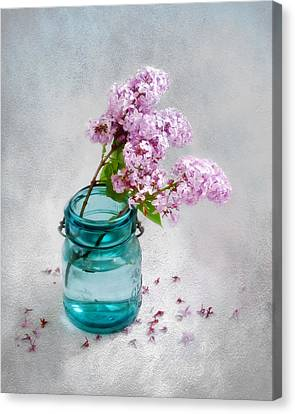 Lilacs In A Glass Jar Still Life Canvas Print by Louise Kumpf