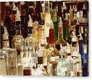 Liquor Bottles Canvas Print by Methune Hively