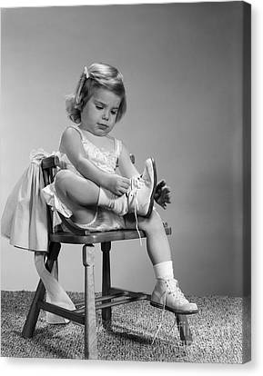 Tying Shoe Canvas Print - Little Girl Putting On Shoes, C.1960s by H. Armstrong Roberts/ClassicStock