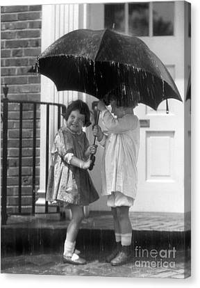 Sharing Canvas Print - Little Girls Sharing An Umbrella by H. Armstrong Roberts/ClassicStock
