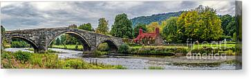 Llanrwst Bridge And Tea Room Canvas Print by Adrian Evans