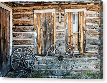 Log Cabin And Wagon Wheels Canvas Print by Paul Freidlund