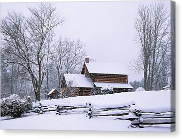 Log Cabin In Snow Canvas Print by Alan Lenk