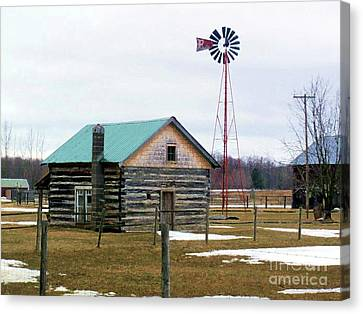 Log Cabin With Windmill Canvas Print by Desiree Paquette