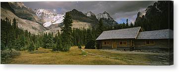 Log Cabins On A Mountainside, Yoho Canvas Print by Panoramic Images