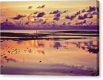 Lone Fisherman In Distance During Beautiful Reflected Sunset With Dramatic Clouds In Maldives Canvas Print