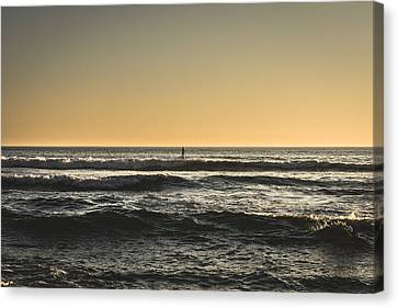 Lone Paddler At Sunset Canvas Print by Marco Oliveira