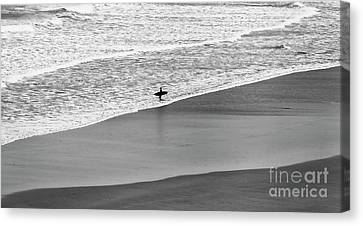 Canvas Print featuring the photograph Lone Surfer by Nicholas Burningham