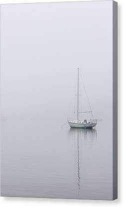 Lonely Boat In The Fog  Canvas Print by John McGraw