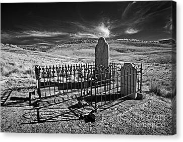 Lonely Graves Canvas Print by Russ Brown