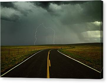 Long And Winding Road Against Lighting Strike Canvas Print by DaveArnoldPhoto.com
