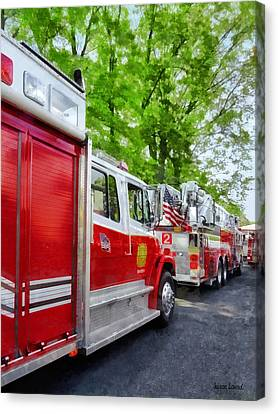 Long Line Of Fire Trucks Canvas Print by Susan Savad