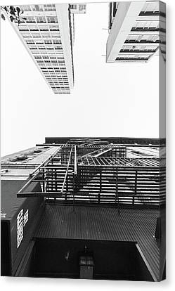 Nyc Fire Escapes Canvas Print - Looking Up Fire Escape Nyc 3 by John McGraw