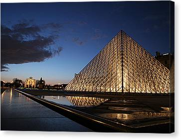 Louvre Puddle Reflection Canvas Print by Joshua Francia