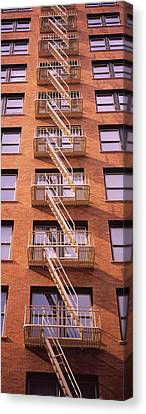 Low Angle View Of Fire Escape Ladders Canvas Print