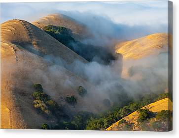 Low Clouds Between Hills Canvas Print by Marc Crumpler