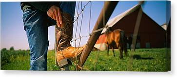 Low Section View Of A Cowboy Adjusting Canvas Print
