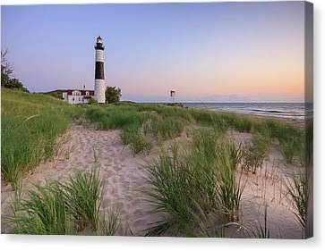 Canvas Print featuring the photograph Ludington Beach And Big Sable Point Lighthouse by Adam Romanowicz
