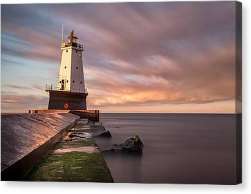 Ludington Light Sunrise Long Exposure Canvas Print by Adam Romanowicz
