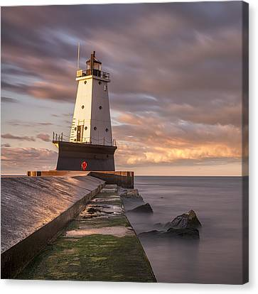 Canvas Print featuring the photograph Ludington North Breakwater Light At Dawn by Adam Romanowicz