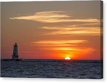 Canvas Print featuring the photograph Ludington North Breakwater Light At Sunset by Adam Romanowicz