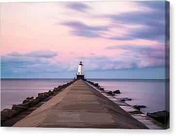 Canvas Print featuring the photograph Ludington North Breakwater Light Sunrise by Adam Romanowicz
