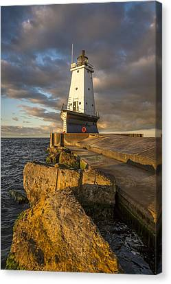 Canvas Print featuring the photograph Ludington North Breakwater Lighthouse At Sunrise by Adam Romanowicz