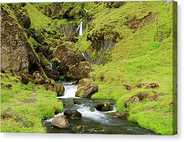 Canvas Print featuring the photograph Lush Icelandic Falls by Brad Scott