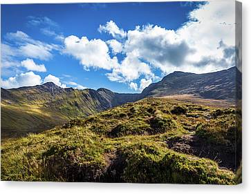 Canvas Print featuring the photograph Macgillycuddy's Reeks And Valleys In Kerry In Ireland  by Semmick Photo