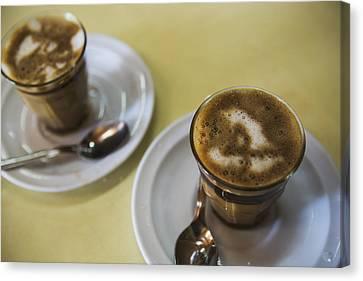 Machiato Coffee In The Tomoca Coffee Canvas Print by Toby Adamson