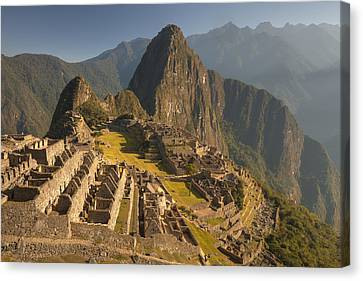 Machu Picchu At Dawn Near Cuzco Peru Canvas Print by Colin Monteath