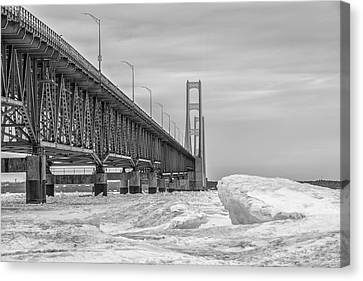 Canvas Print featuring the photograph Mackinac Bridge Icy Black And White  by John McGraw