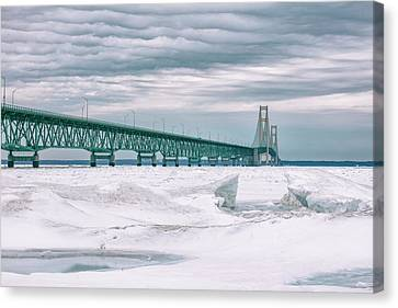 Canvas Print featuring the photograph Mackinac Bridge In Winter During Day by John McGraw