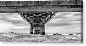 Canvas Print featuring the photograph Mackinac Bridge In Winter Underneath  by John McGraw