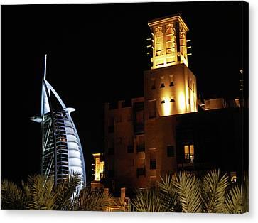Madinat And Burj Al Arab Hotels Canvas Print by Graham Taylor