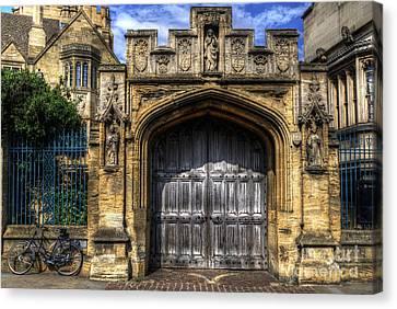 Magdalen College Door - Oxford Canvas Print by Yhun Suarez