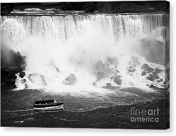 Maid Of The Mist Boat Below The American And Bridal Veil Falls Niagara Falls Ontario Canada Canvas Print by Joe Fox