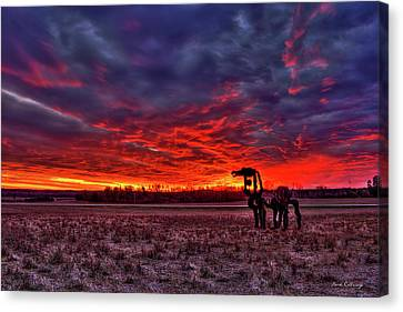 Majestic Red Clouds Winter Sunset The Iron Horse Art Canvas Print by Reid Callaway