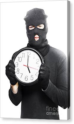 Male Criminal In Mask Holding A Clock Canvas Print