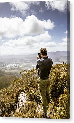 Male Tourist Taking Photo On Mountain Top Canvas Print by Jorgo Photography - Wall Art Gallery