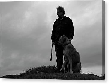 Man And His Dog In Silhouette Canvas Print by Lorraine Devon Wilke