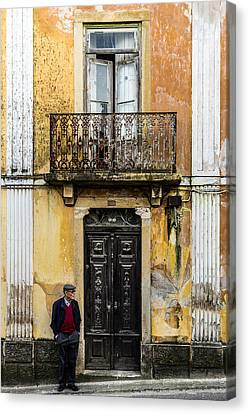 Man At The Door Canvas Print by Marco Oliveira