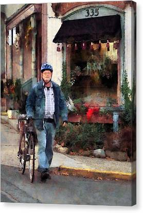 Man Crossing Street With Bicycle Canvas Print by Susan Savad