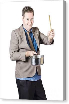 Man Holding Saucepan And Spatula Canvas Print