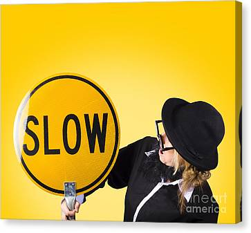 Man Holding Slow Sign During Adverse Conditions Canvas Print by Jorgo Photography - Wall Art Gallery