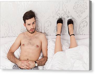 Man In Bed Wondering About The Lying Position Of His Girlfriend Canvas Print by Wolfgang Steiner