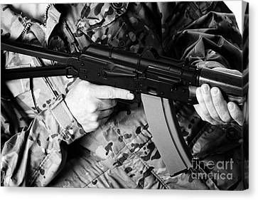 Ak-47 Canvas Print - Man In Combat Fatigues Holding Aks-47u Close Quarter Combat Kalashnikov Rifle by Joe Fox